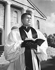 Reverend Akaka with Bible